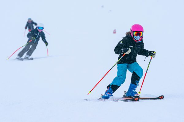 People wear masks while skiing at Alyeska Resort on opening day, Friday, Dec. 18, 2020 in Girdwood. The resort requires masks to be worn while in lift lines, while riding the chairlift, and all public spaces, but allows them to be removed while skiing on the mountain away from other people. (Loren Holmes / ADN)