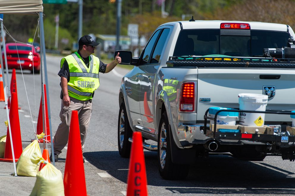Dare County Emergency Management has set up road blocks at all entry points to the county in North Carolina's Outer Banks. Drivers must present proof of local residency or other identification to gain entry. This checkpoint, photographed April 9, 2020, is at the end of the Wright Brothers Bridge in the village of Southern Shores. MUST CREDIT: Photo for The Washington Post by Daniel Pullen