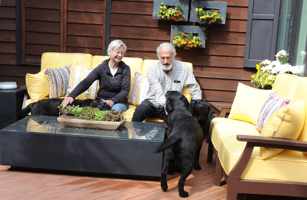 The subterranean outdoor living space of the Isaacs home is a favorite for them and their three English labs. (Anne Raup / ADN)