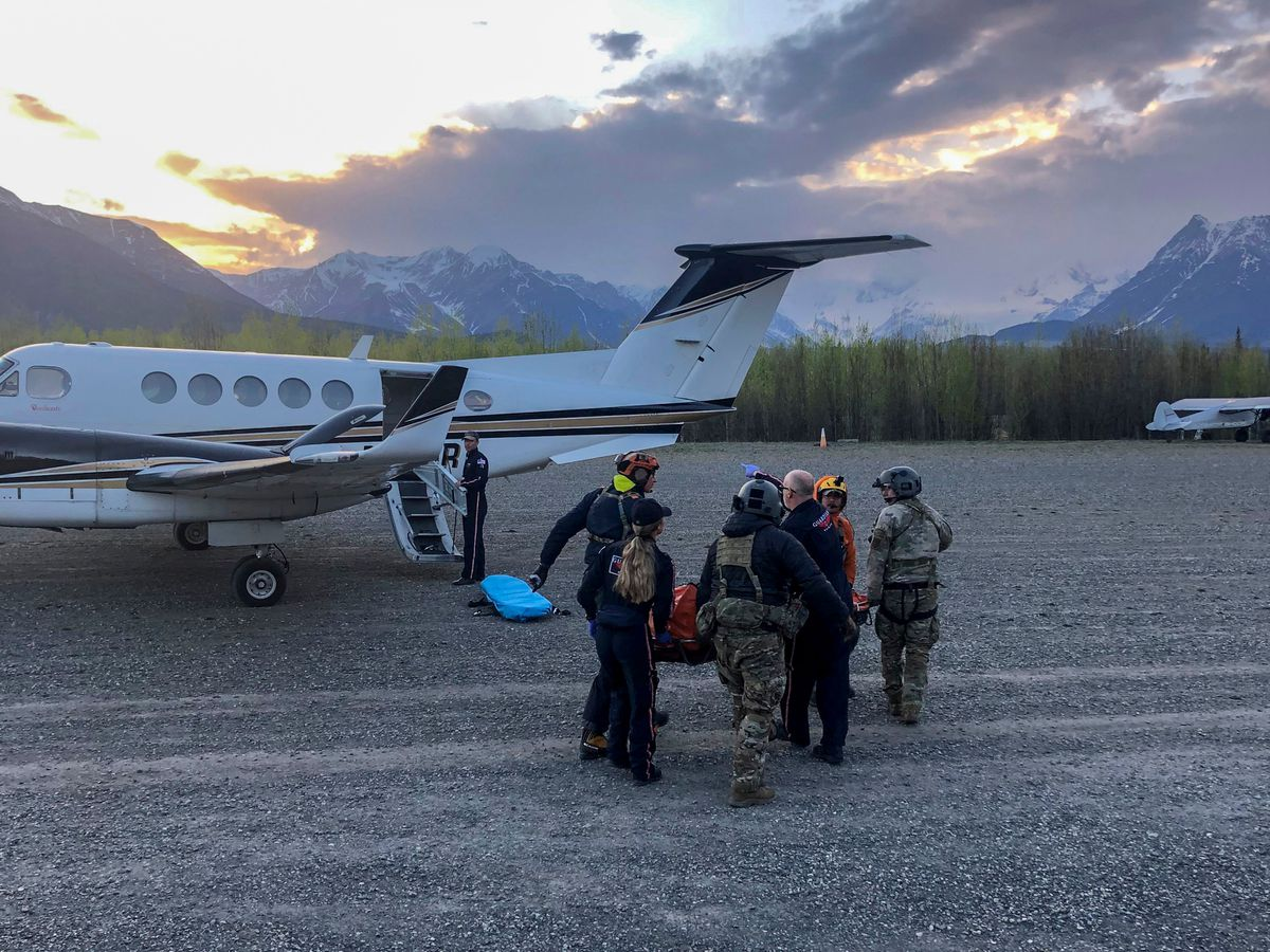 Pararescue personnel with the Alaska Air National Guard's 212th Rescue Squadron transload an injured hiker from a 210th Rescue Squadron HH-60 Pave Hawk to a Guardian Flight, AirMedCare air ambulance after conducting a multi-agency rescue from an avalanche near Donoho Peak in Wrangell-St. Elias National Park and Preserve on Wednesday. (Courtesy photo by Stephens Harper)