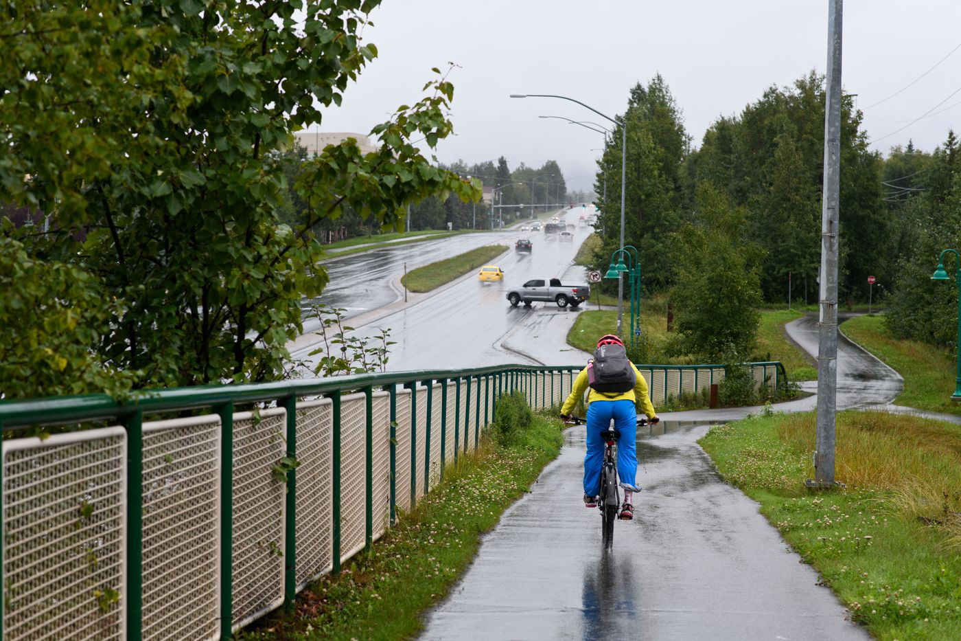 Kikkan Randall rides from her chemotherapy treatment to her mother's home in East Anchorage through the rain on Aug. 21. To stay active, Randall tried to bike to as many of treatments as she could. (Marc Lester / ADN)