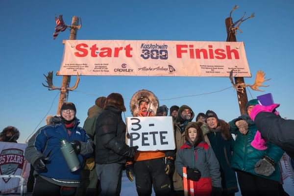 Peter Kaiser poses for a photo with supporters after winning his third straight Kuskokwim 300 sled dog race Sunday, Jan. 22, 2017 in Bethel. (Loren Holmes / Alaska Dispatch News)