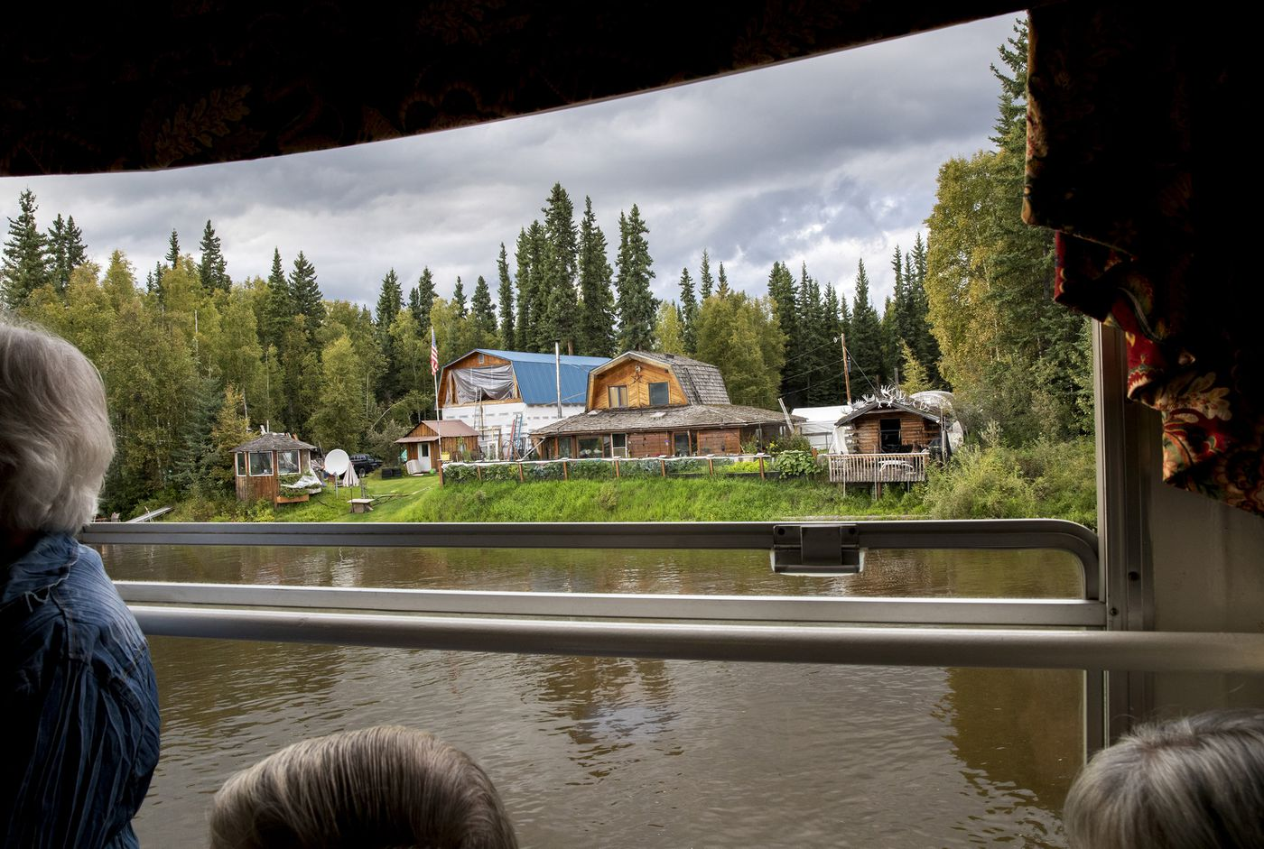 Homes are seen along the Chena River waterfront during a fundraiser cruise for John Sturgeon in Fairbanks. Photo for the Washington Post by Kate Wool