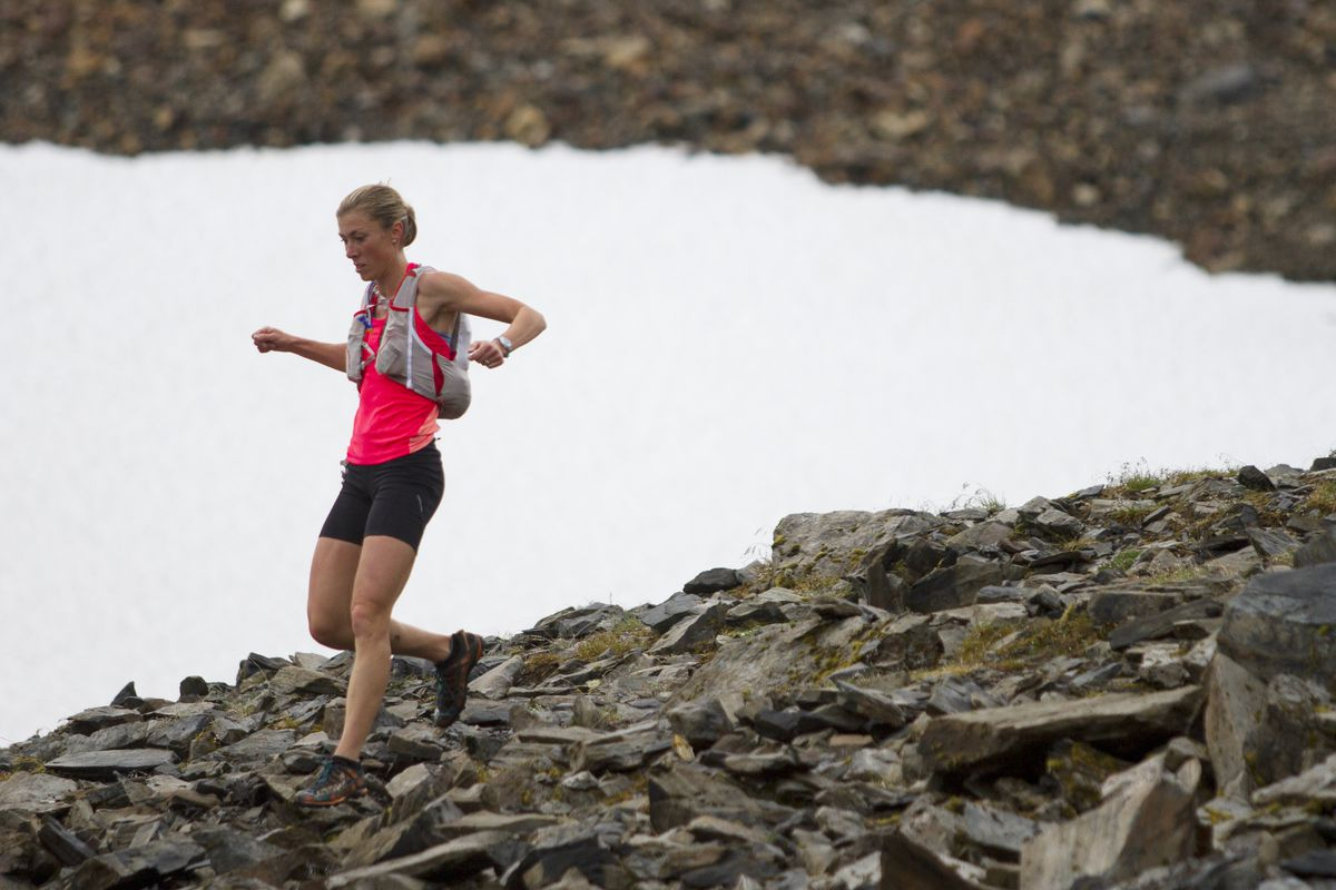 Three-time champion Christy Marvin runs past Raven Glacier during the 2016 Crow Pass Crossing. (Sarah Bell / ADN archives)