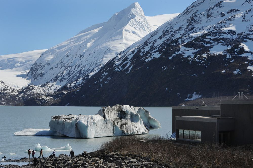 Icebergs rest grounded near shore in Portage Lake near the Begich, Boggs Visitor Center on Sunday, April 14, 2019. (Bill Roth / ADN)