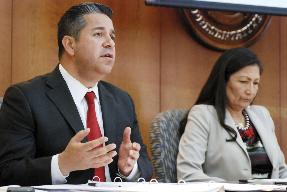 File - In this April 15, 2019 file photo, U.S. Reps. Ben Ray Luján, left, and Debra Haaland of New Mexico speak at a field hearing of a House Subcommittee on Energy and Mineral Resources in Santa Fe, N.M. Lawmakers are making a renewed push in Congress to ban collectors and vendors from exporting Native American ceremonial items. (AP Photo/Morgan Lee, File)