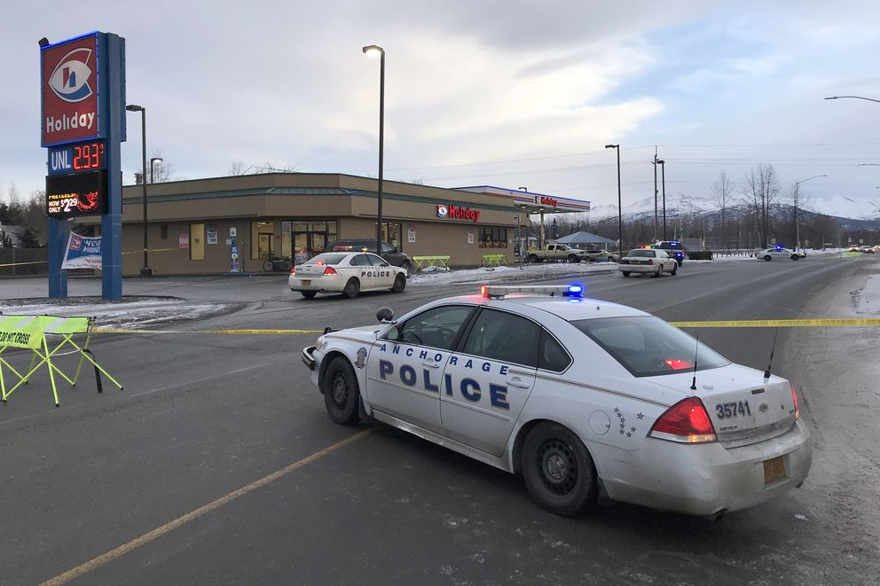 Anchorage police investigate the scene of a homicide at the Holiday station in Mountain View, Monday morning, Dec. 16, 2019. (Bill Roth / ADN)