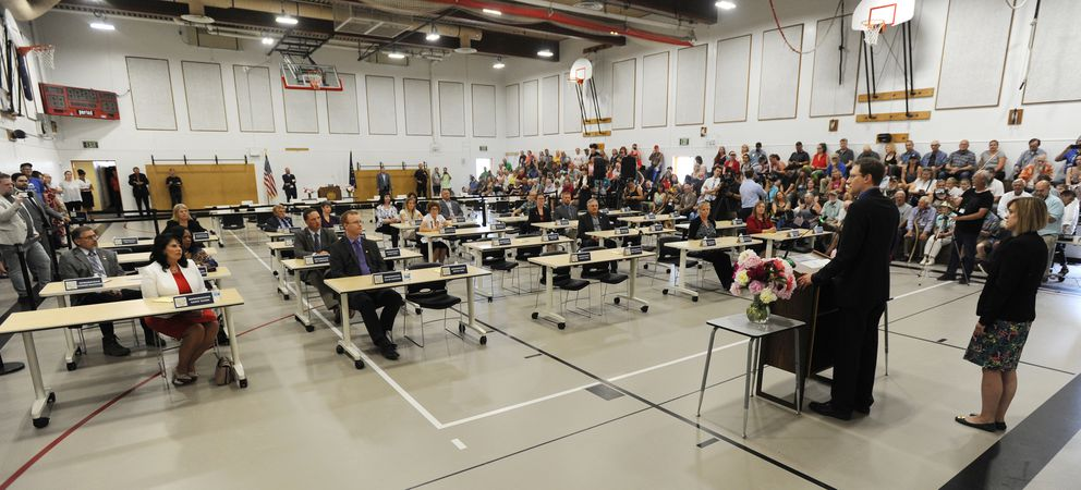 State Rep. Lance Pruitt, R-Anchorage, and Sen. Mia Costello, R-Anchorage, speak to some state legislators gathered at Wasilla Middle School on Monday. A larger group of lawmakers met in Juneau. (Bill Roth/ADN)