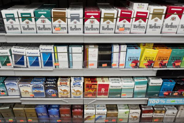 FILE - This Aug. 28, 2017 file photo shows cigarettes displayed on a store shelf in New York. Since 2009, the U.S. smoking rate has fallen by about a third _ from 21% to 14% of adults. But Micah Berman, a public health lawyer at Ohio State University, says this decline continues a decades-long trend attributable to longstanding measures, such as smoking bans, cigarette taxes and anti-smoking campaigns. (AP Photo/Mark Lennihan, File)