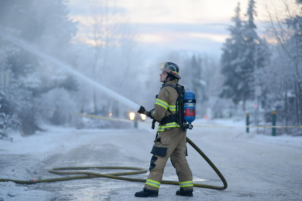 An Anchorage firefighter works at a fire at the Jubilee Christian Center after a 7.0 earthquake, Nov. 30, 2018. (Anne Raup / ADN)