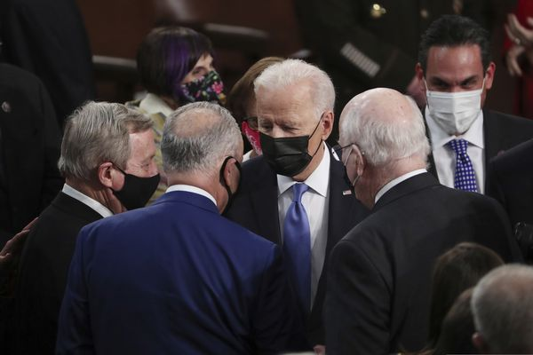 President Joe Biden speaks to Sen. Dick Durbin, D-Ill.,, left, Senate Majority Leader Chuck Schumer of N.Y., center, and Sen. Patrick Leahy, D-Vt., after speaking to a joint session of Congress Wednesday, April 28, 2021, in the House Chamber at the U.S. Capitol in Washington. (Michael Reynolds/Pool via AP)