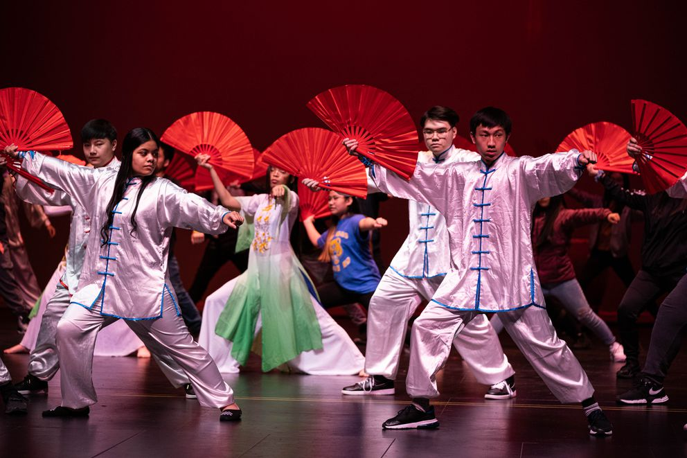 Bartlett Chinese language students perform a Kung Fu fan dance Friday. (Loren Holmes / ADN)