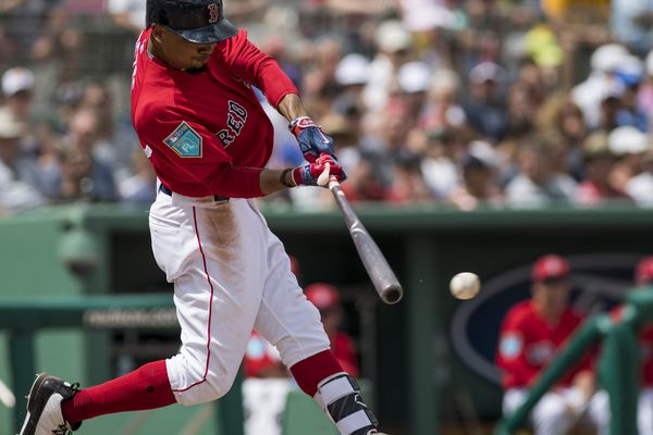 Mar 20, 2018; Fort Myers, FL, USA; Boston Red Sox outfielder Mookie Betts (50) hits an RBI single in the fourth inning scoring third baseman Rafael Devers against the Pittsburgh Pirates at JetBlue Park. Mandatory Credit: Douglas DeFelice-USA TODAY Sports