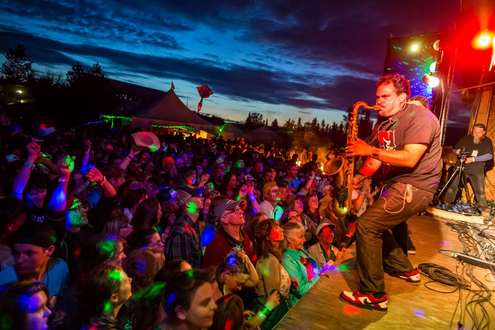 Ozomatli, a Latin-influenced dance band, played late into the night during the second day of Salmonstock (now called Salmonfest) on August 2, 2014. (Loren Holmes / Alaska Dispatch News)