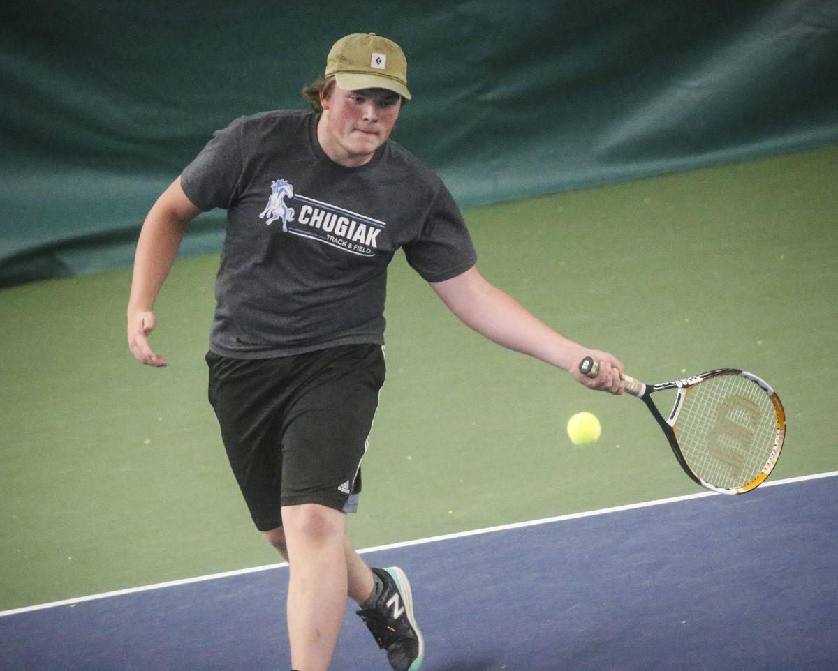 Chugiak High School's Matt Keller volleys with West Anchorage High's Kai Binder during a match last week. (Emily Mesner / ADN)