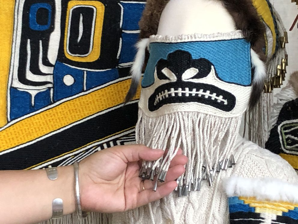 Lily Hope spent nearly 60 hours making this facemask using traditional Tlingit weaving techniques. The mask, created for an art contest, is intended for the Burke Museum of Natural History and Culture in Seattle. (James Brooks / ADN)