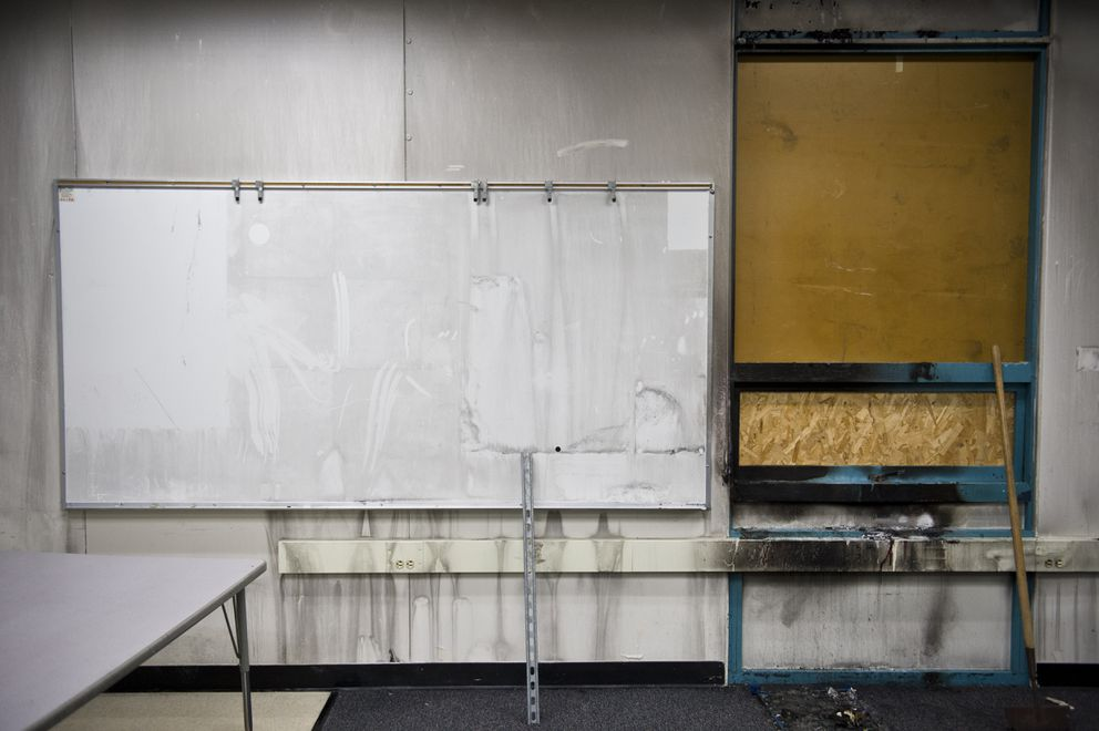 Soot coats a wall in a fourth grade classroom at College Gate Elementary days after fire damaged a fourth grade classroom there. (Marc Lester / ADN)