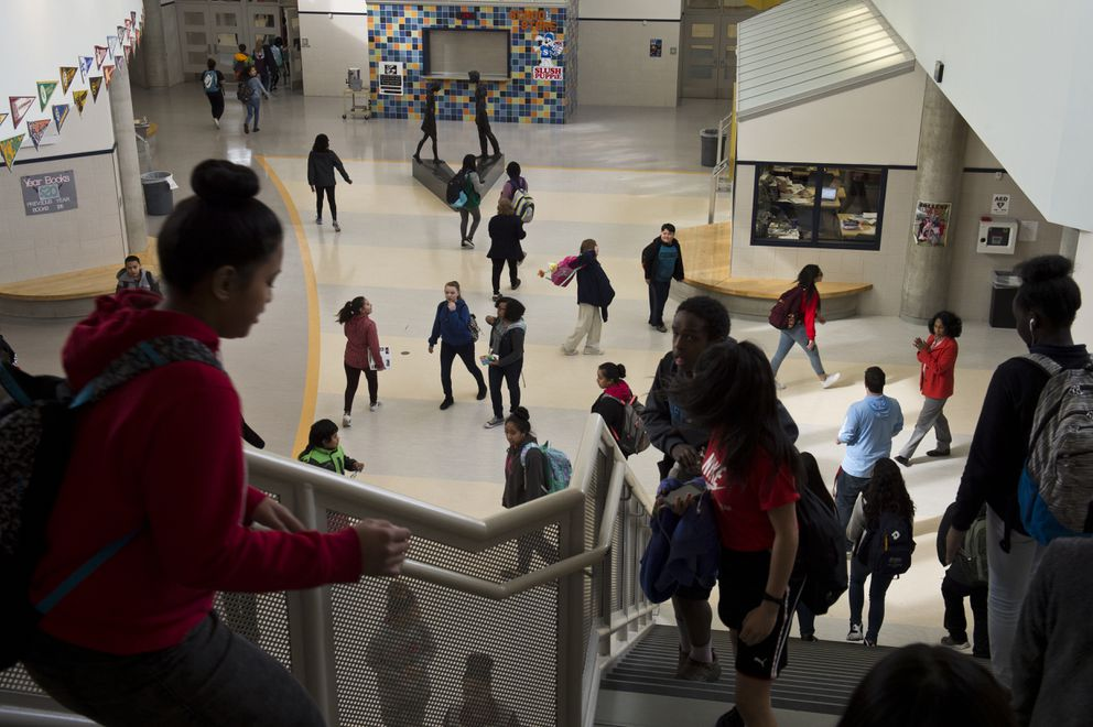 Students at Clark Middle School pass each other as classes let out of the day on April 6, 2018.  (Marc Lester / ADN)