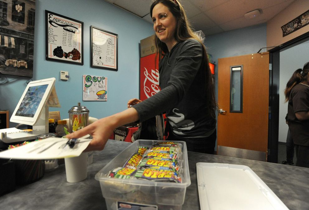 Kat Hubble of Kat's Epic Trail Bites delivers her high-protein, fruit-sweetened cookies to The Daily Dosecoffee shop in the Lake Otis Medical Plaza on Wednesday, May 25, 2016. (Bill Roth / Alaska Dispatch News)