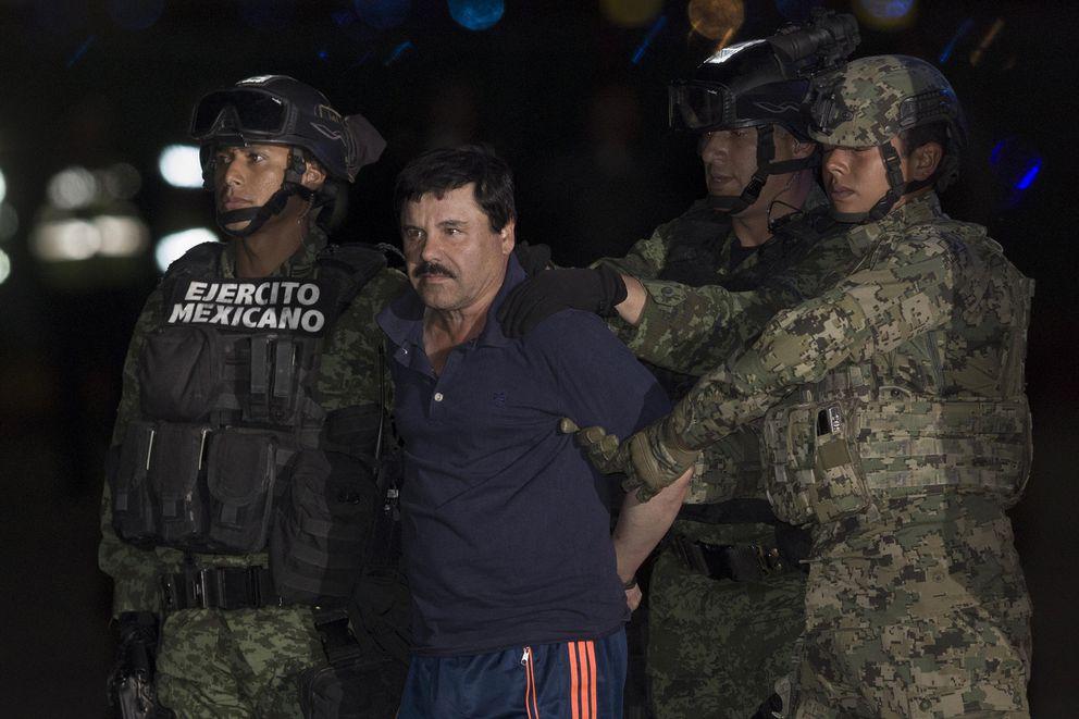 "Soldiers escort Joaquin Guzman Loera, alias ""El Chapo,"" upon his arrival to the hangar of the Attorney General's Office, in Mexico City on Jan. 8, 2016. (Pedro Mera/Xinhua/Sipa USA/TNS file)"