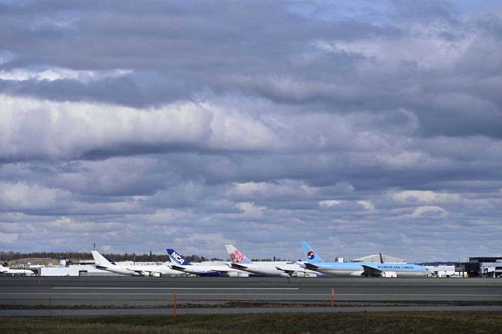 Cargo planes from companies including Nippon Cargo Airlines, China Airlines Cargo and Korean Air Cargo, are parked in a row at Ted Stevens Anchorage International Airport on May 11, 2021. (Marc Lester / ADN)