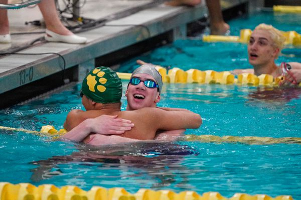 Soldotna's Ethan Evans hugs Service's Brian Jarupakorn after Jarupakorn nearly beat the state record in the 50 yard freestyle race Saturday, Nov. 9, 2019 during the state swimming and diving championships at Bartlett. (Loren Holmes / ADN)