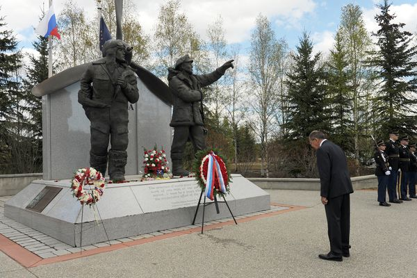 Minister of Foreign Affairs of the Russian Federation, Sergey Lavrov, bows his head during a wreath laying ceremony at the Alaska Siberia Lendlease Memorial in Fairbanks, Alaska, on Thursday, May 11, 2017. The memorial honors the U.S. and Soviet pilots who ferried planes from the U.S. to Siberia during World War II. At right stands the Alaska Army National Guard honor guard. (Bob Hallinen / Alaska Dispatch News)