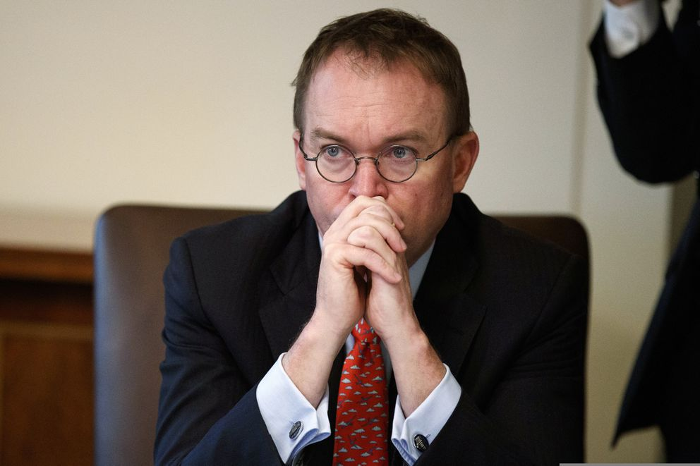FILE- In this Jan. 2, 2019, file photo White House chief of staff Mick Mulvaney listens as President Donald Trump speaks during a cabinet meeting at the White House in Washington. Budget negotiators will meet Monday to revive talks over border security issues that are central to legislation to prevent key parts of the government from shutting down on Saturday, but an air of pessimism remains after talks broke down over the weekend. (AP Photo/Evan Vucci, File)