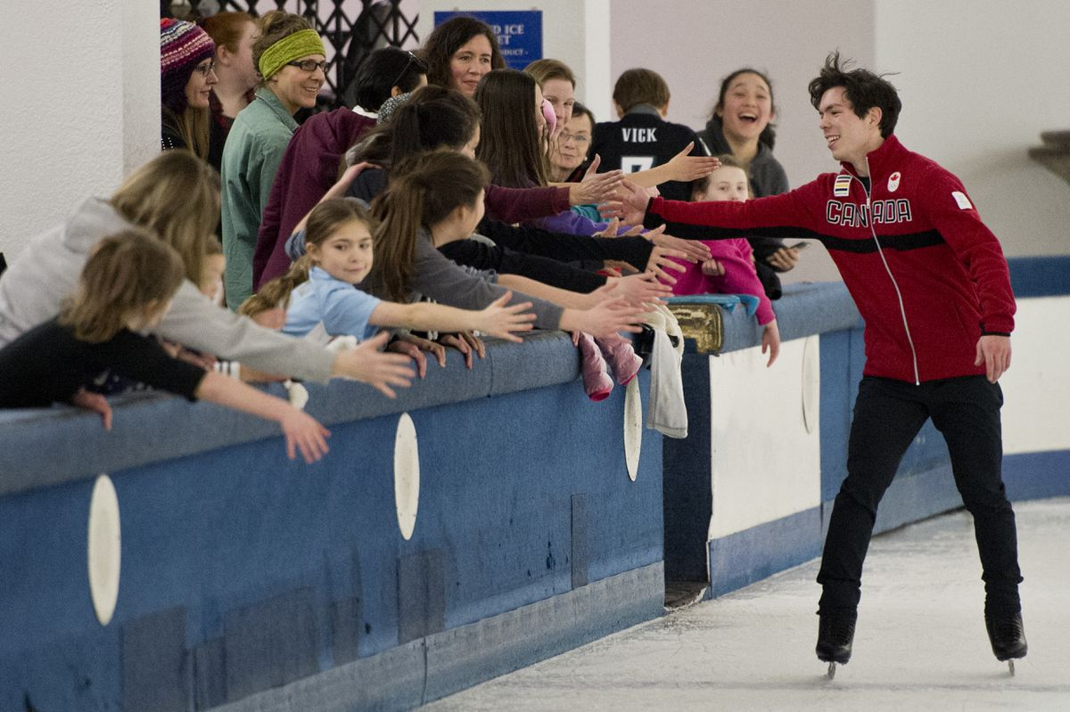 Keegan Messing high-fives fans at a send-off party hosted by the Alaska Association of Figure Skaters at the Dimond Center Ice Chalet.  (Marc Lester / ADN)