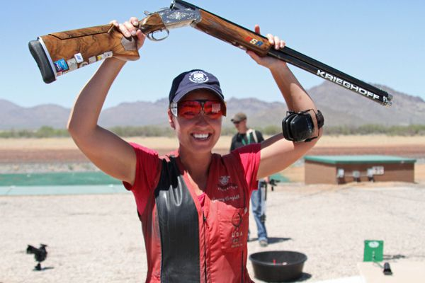 In this Sunday, May 20, 2012, photo provided by USA Shooting, Corey Cogdell hoists her shotgun at the U.S. Olympic Trials in Tucson, Ariz. Cogdell's road to London included more than two weeks living alone in a camper in the Arizona heat this month, a temporary home on the range that paid off Sunday when the Eagle River, Alaska, woman clinched the country's lone Olympic berth in women's trapshooting. (AP Photo/USA Shooting, Katie Yergensen)