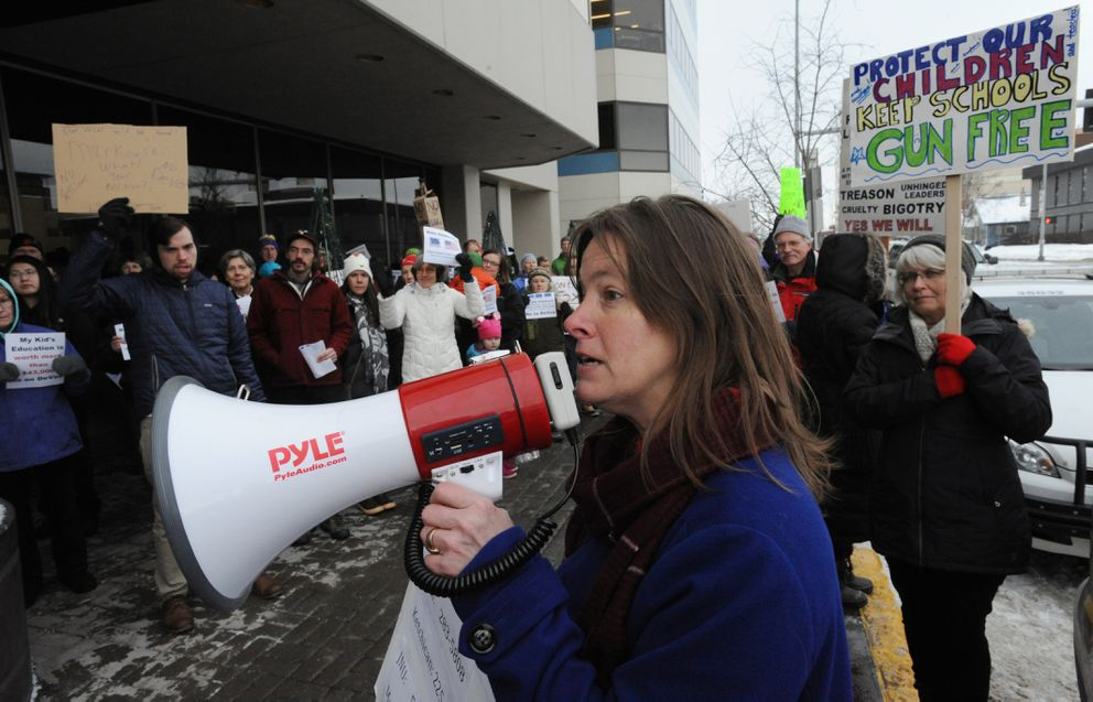 Alyse Galvin of Great Alaska Schools leads activists as they chant outside Sen. Lisa Murkowski's Anchorage office. (Bill Roth / Alaska Dispatch News)