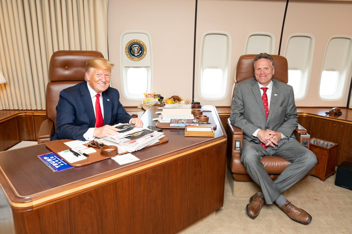 Alaska Gov. Mike Dunleavy meets with President Donald Trump on Air Force One during Trump's stop at Joint Base Elmenorf-Richardson on June 26, 2019. (White House photo by Sheila Craighead)