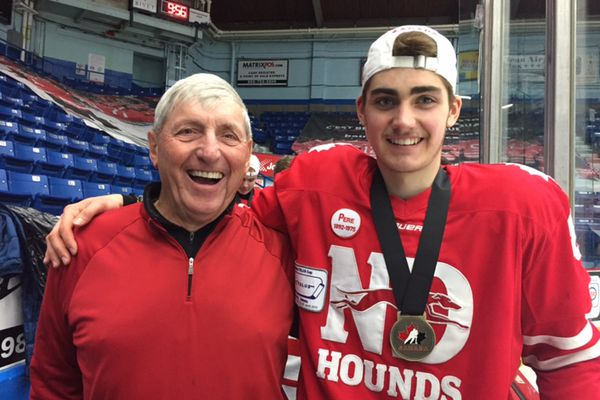 Eagle River's Zach Plucinski, right, poses for a photo with his grandfather, Gary McKissock, following the Notre Dame Hounds' victory in the Telus Cup final on April 29, 2018. (Photo courtesy Heather Plucinski)