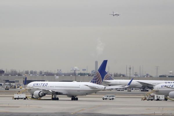 FILE - In this Wednesday, Jan. 23, 2019 file photo, United Airlines jets are seen as a plane approaches Newark Liberty International Airport, in Newark, N.J. United Airlines will woo high-fare passengers by retrofitting more than 100 planes to add more premium seats on key routes. United announced the moves Wednesday, Feb. 6, 2019. (AP Photo/Julio Cortez, File)