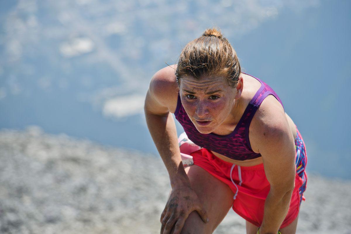 Hannah Lafleur, of Seward, reaches the top of the Mount Marathon course on July 4, 2019, in Seward. (Marc Lester / ADN)