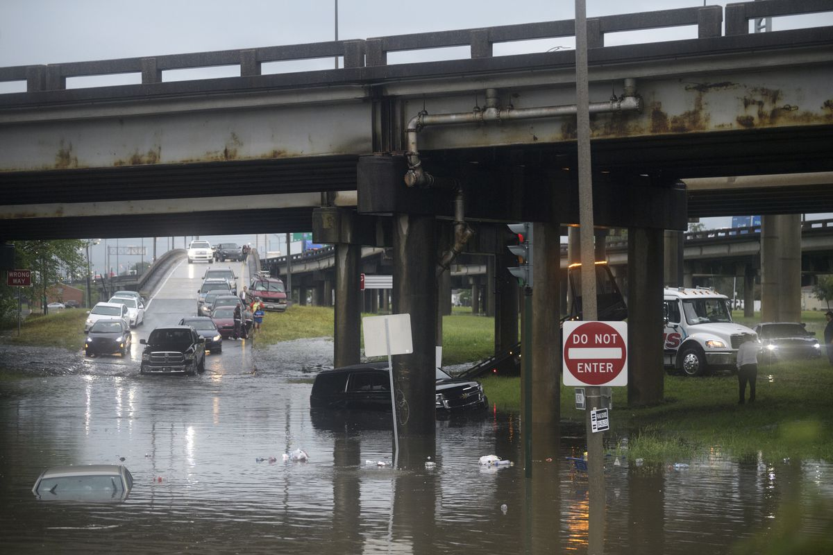 Motorist try to maneuver around flooding at the intersection of Franklin Ave. and 610 following heavy rain, Wednesday, July 10, 2019, in New Orleans. (Max Becherer/The Advocate via AP)