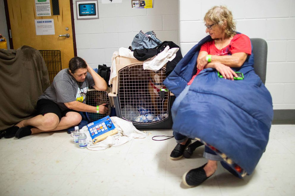 Serina Collins, left, and Terry Lamotta with their dogs, Mikey and Rocky, in the animal shelter area at Lawton Chiles High School. Photo by Kevin D. Liles for The Washington Post