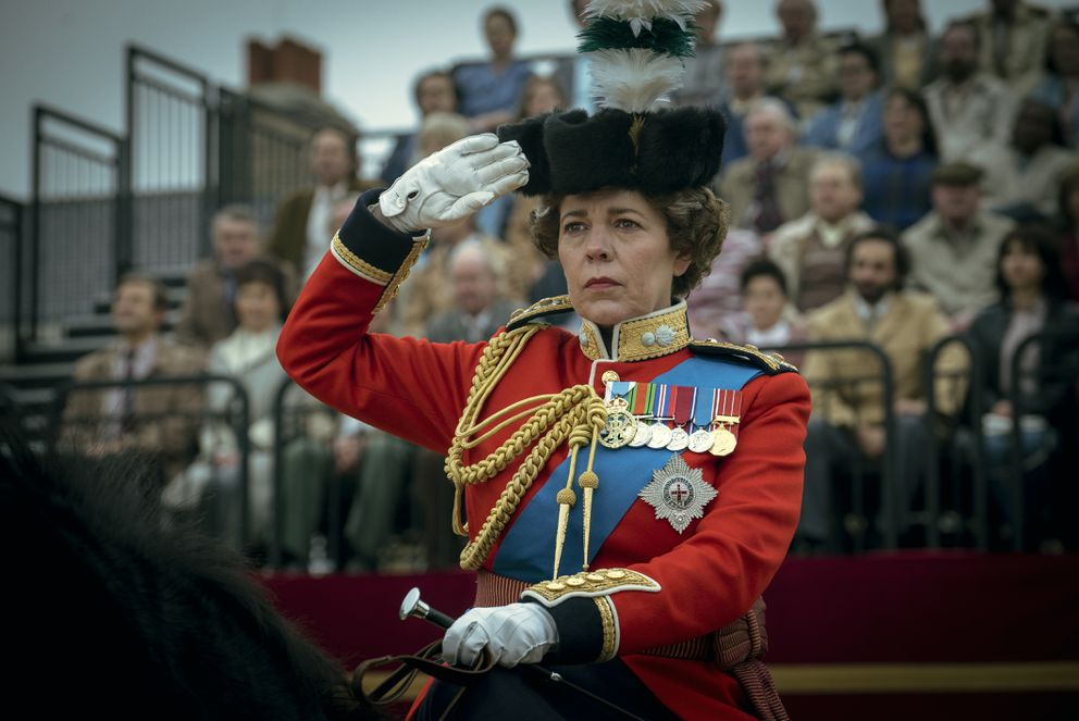 This image released by Netflix shows Olivia Colman as Queen Elizabeth II in a scene from 'The Crown. ' The show was nominated for a Golden Globe for best drama series on Wednesday, Feb. 3, 2021. (Liam Daniel/Netflix via AP)