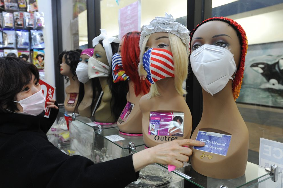 Queen Beauty Supply owner Aruem Kim said everything in her Northway Mall store is 50% off, except face masks and hand sanitizer, as she prepares to move to a new location on Northern Lights Boulevard. (Bill Roth / ADN)
