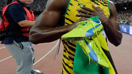 World's fastest man taken down by cameraman on a cart