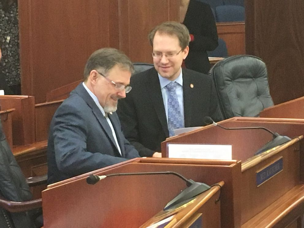 Rep. George Rauscher, R-Sutton, (left) talks with Rep. Lance Pruitt, R-Anchorage, during a House floor session Friday. Rauscher and Pruitt were members of the 'Group of Eight ' charged with drafting a backstop deal to end the ongoing leadership deadlock in the House. (James Brooks / ADN)