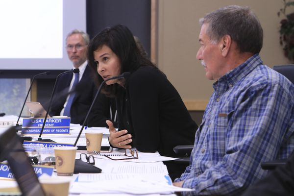 University of Alaska Regent Gloria O'Neill, center, speaks while UA President Jim Johnsen, left, and Regent John Bania, right, listen at a UA Board of Regents meeting, Tuesday, July 30, 2019, in Anchorage, Alaska. Facing severe budget cuts, regents voted 8-3 to authorize Johnsen to immediately reduce administrative costs and prepare a plan for a transition from three accredited institutions to one. (AP Photo/Dan Joling)