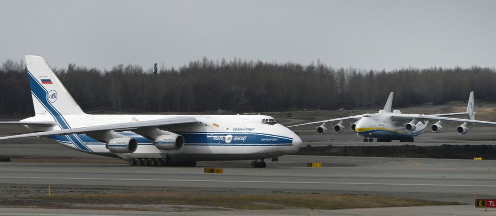 Antonov An-124 Ruslan, left, taxis for departure as the world's largest cargo plane, Antonov An-225 Mriya, arrived at Ted Stevens Anchorage International Airport on Thursday, April 30, 2020, while transporting medical supplies to Canada during the COVID-19 pandemic. (Bill Roth / ADN)