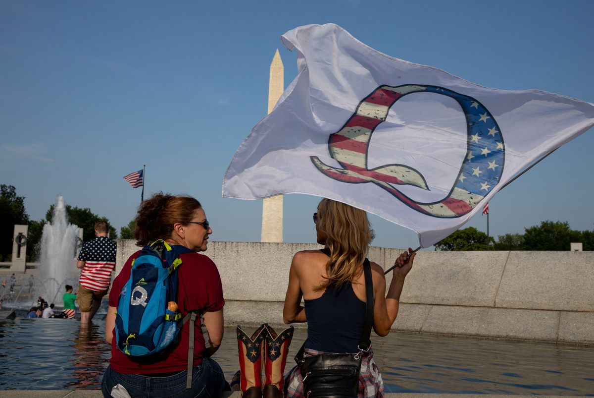 QAnon supporters wait for a military flyover at the World War II Memorial during Fourth of July celebrations in Washington, D.C. Photo for The Washington Post by Evelyn Hockstein