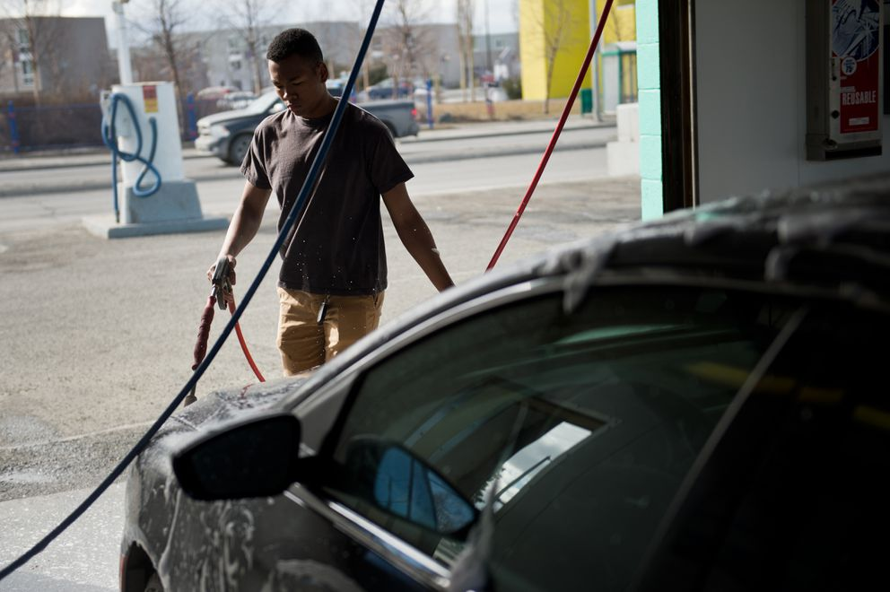 Andrew Samuel washes his car at the busy Mountain View Car Wash on Commercial Drive on April 11, 2018. (Marc Lester / ADN)