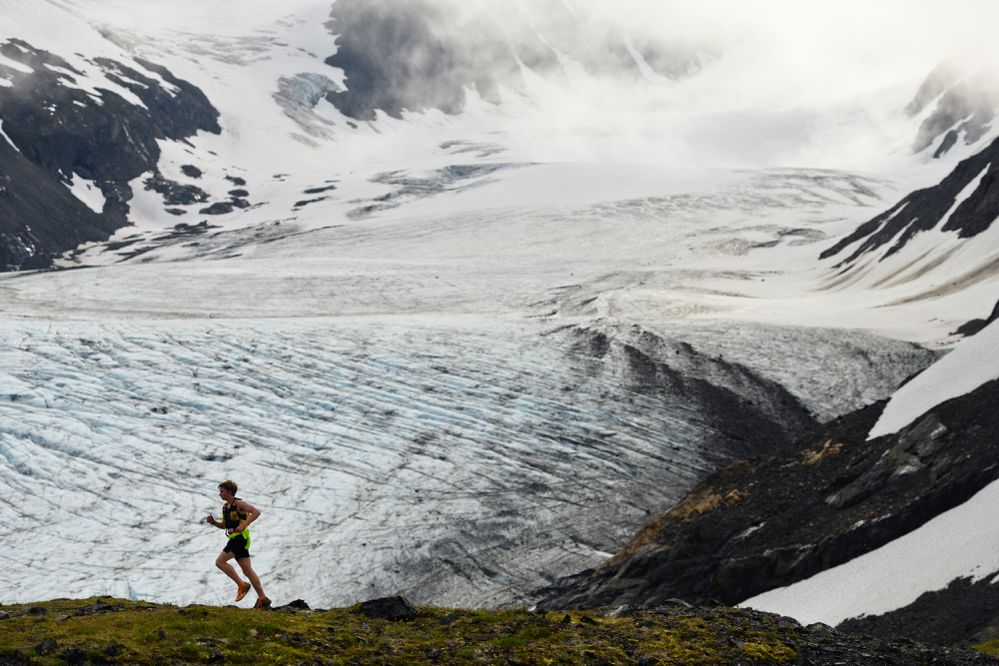 Daniel Bausch passes Raven Glacier during the Crow Pass Crossing backcountry marathon on July 24, 2021. (Marc Lester / ADN)