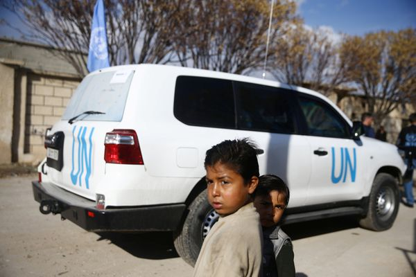 Children stand near a U.N vehicle in the village of Otaya, eastern Ghouta, in Damascus, Syria February 14, 2018. REUTERS/Bassam Khabieh