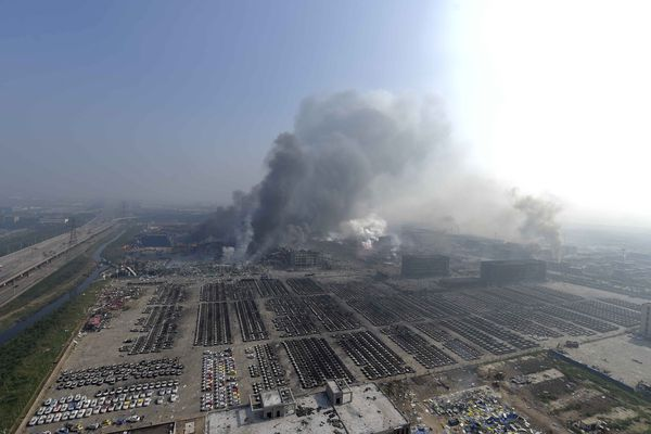 Smoke rises from the site of explosions Thursday in the Binhai New Area in northeastern China's Tianjin municipality.