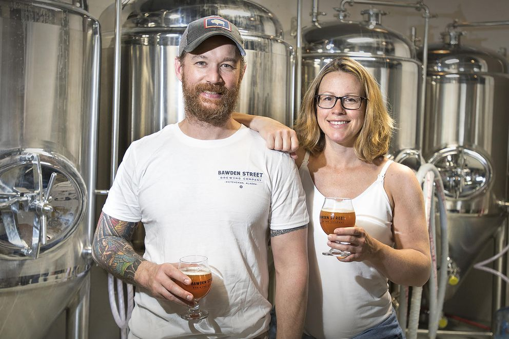 Owners Sean Heismann and Nicole Morin stand for a portrait in the fermentation room at Bawden Street Brewing Co. in Ketchikan on July 24. (Dustin Safranek / Ketchikan Daily News)