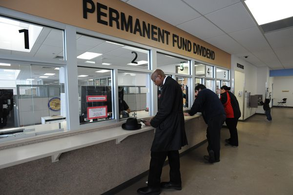 Edgar Lattimore applies for the Alaska Permanent Fund Dividend on Thursday, March 30, 2017, at the PFD office in downtown Anchorage before the filing deadline on Friday. (Bill Roth / Alaska Dispatch News)